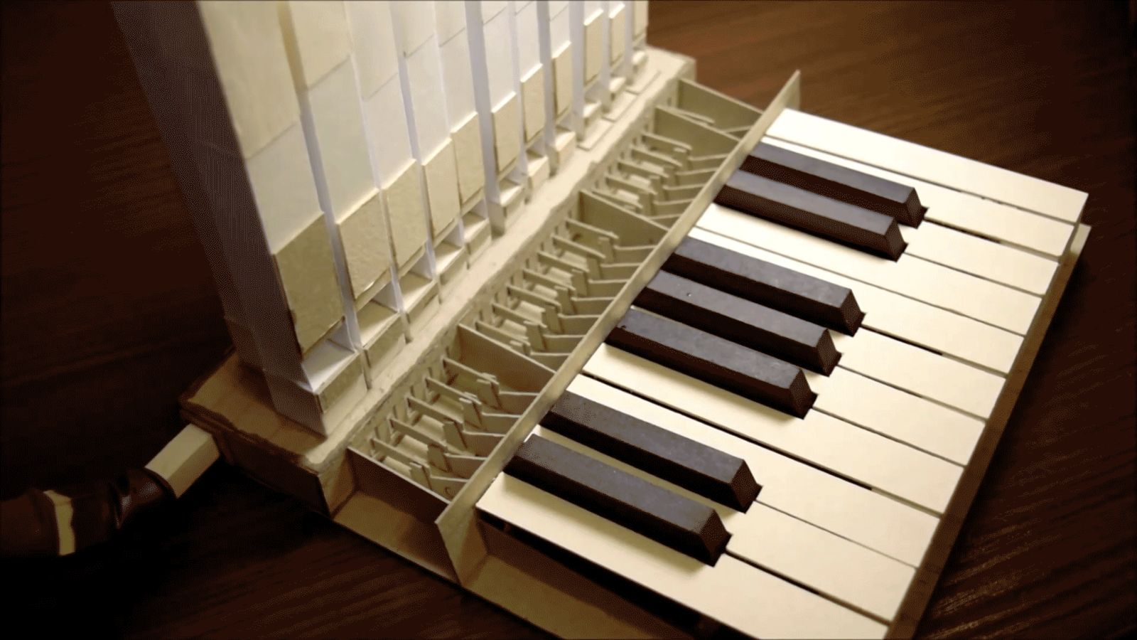 A pipe organ cancost more than $200,000 and weigh thousands of pounds. Not this instrument. The paper organ built by master craftsman Aliaksei Zholner costs and weights only a fraction of that—and it works just like the real thing.