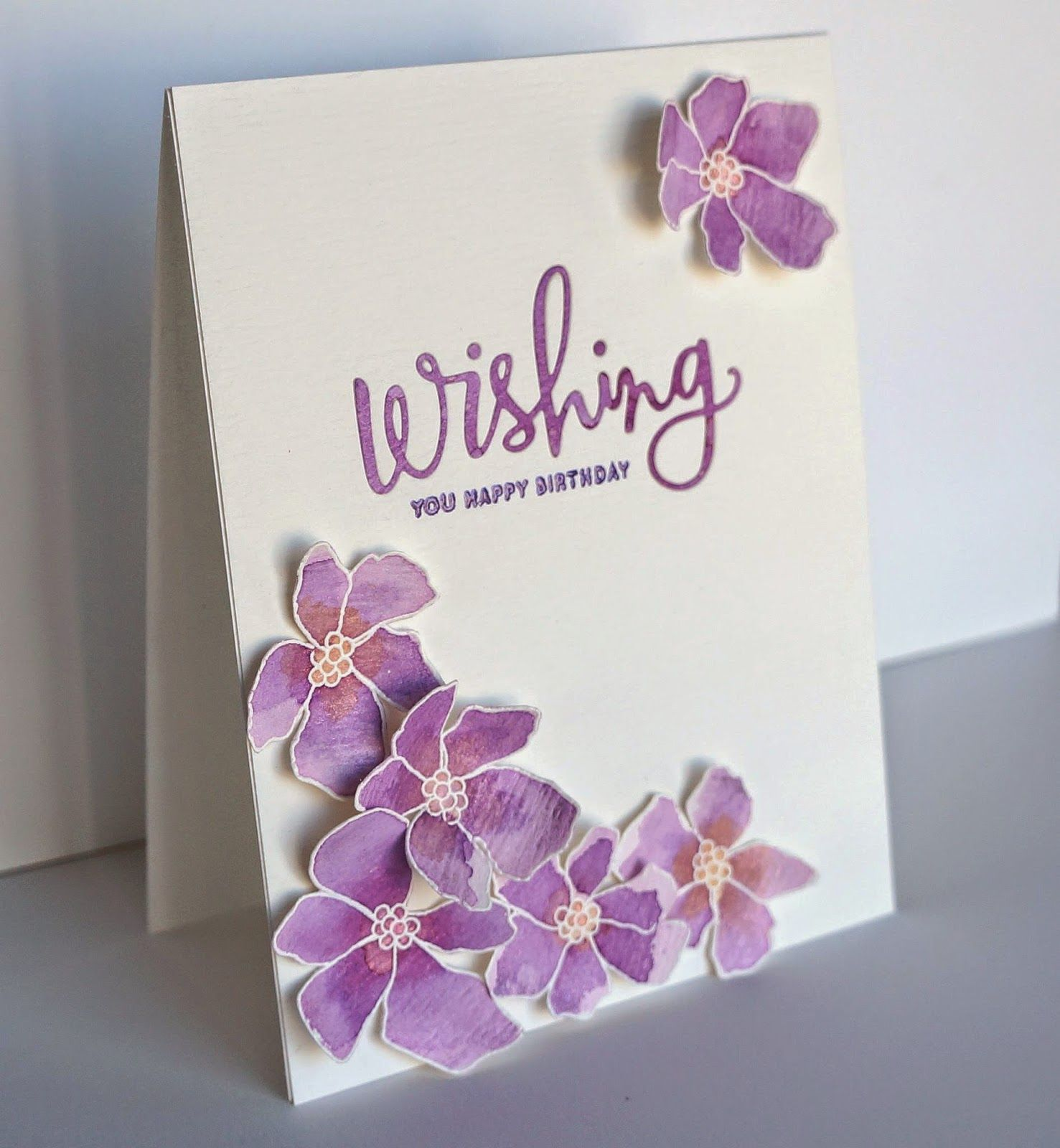 Artful flowers are stamped and cut on watercolor paper to create