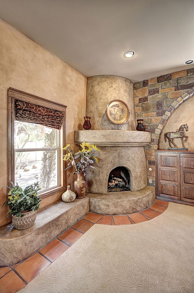 Custom textured and distressed antiqued kiva fireplace - Southwestern home design and remodeling ...