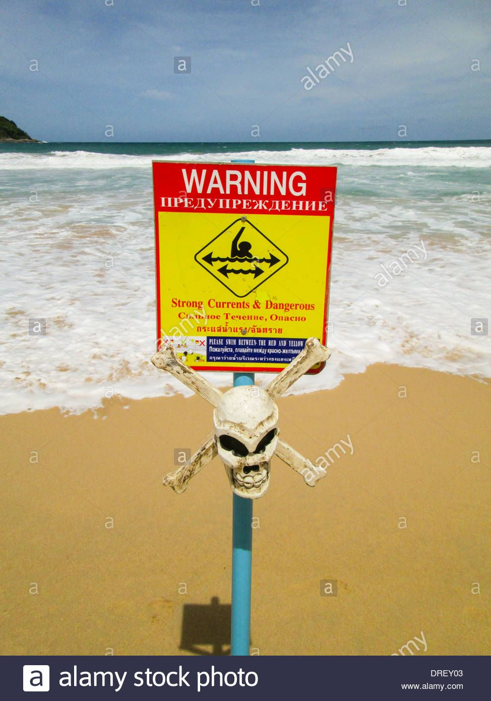 Yellow Sign Post With Skull Is Warning Of Dangerous Currents On A Beach In Phuket Thailand Stock Photo Yellow Sign Beaches In Phuket Photo
