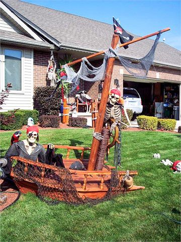 47 Easy Halloween Decorations To Make Right Now Outdoor Halloween Halloween Outdoor Decorations Pirate Halloween Decorations