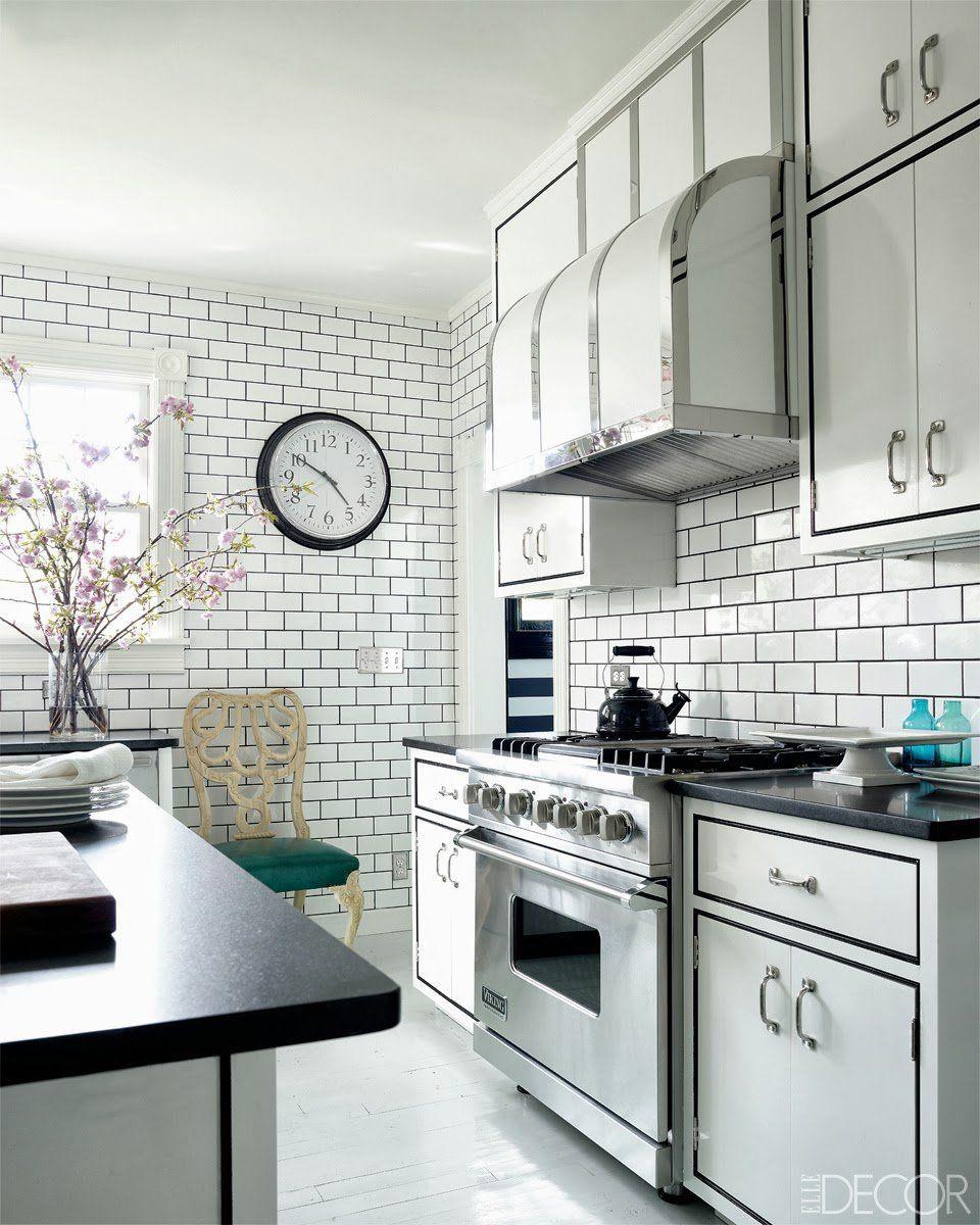 white kitchen subway tiles dark black grout viking stove white arrow ...