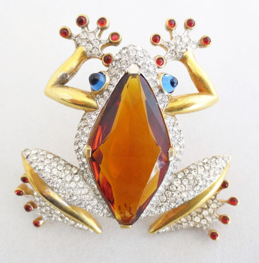 """Circa 1940s. Designed by top TRIFARI designer Alfred Philippe and featured in Brunialti's """"American Costume Jewelry"""" Vol 2. The back of the Frog is a large topaz colored crystal, the eyes are blue cabochons."""