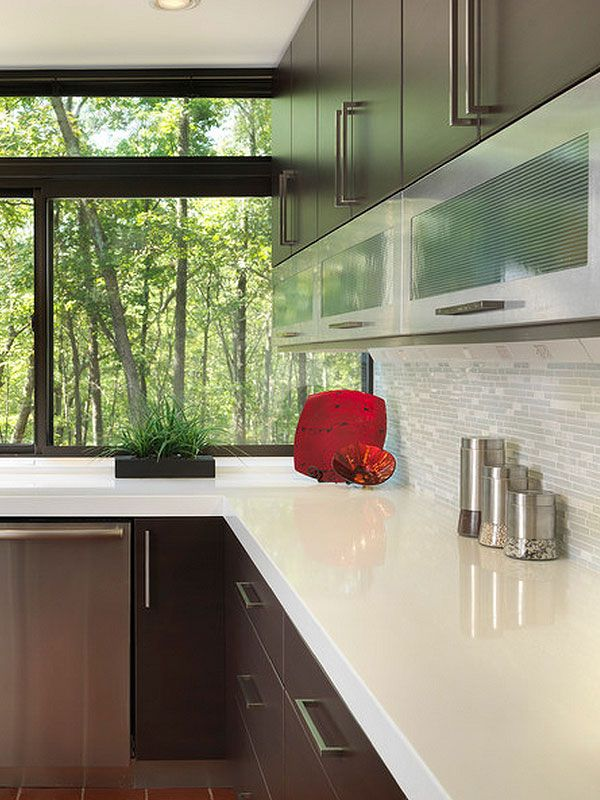 Modern kitchen with white quartz countertop brown cabinets and