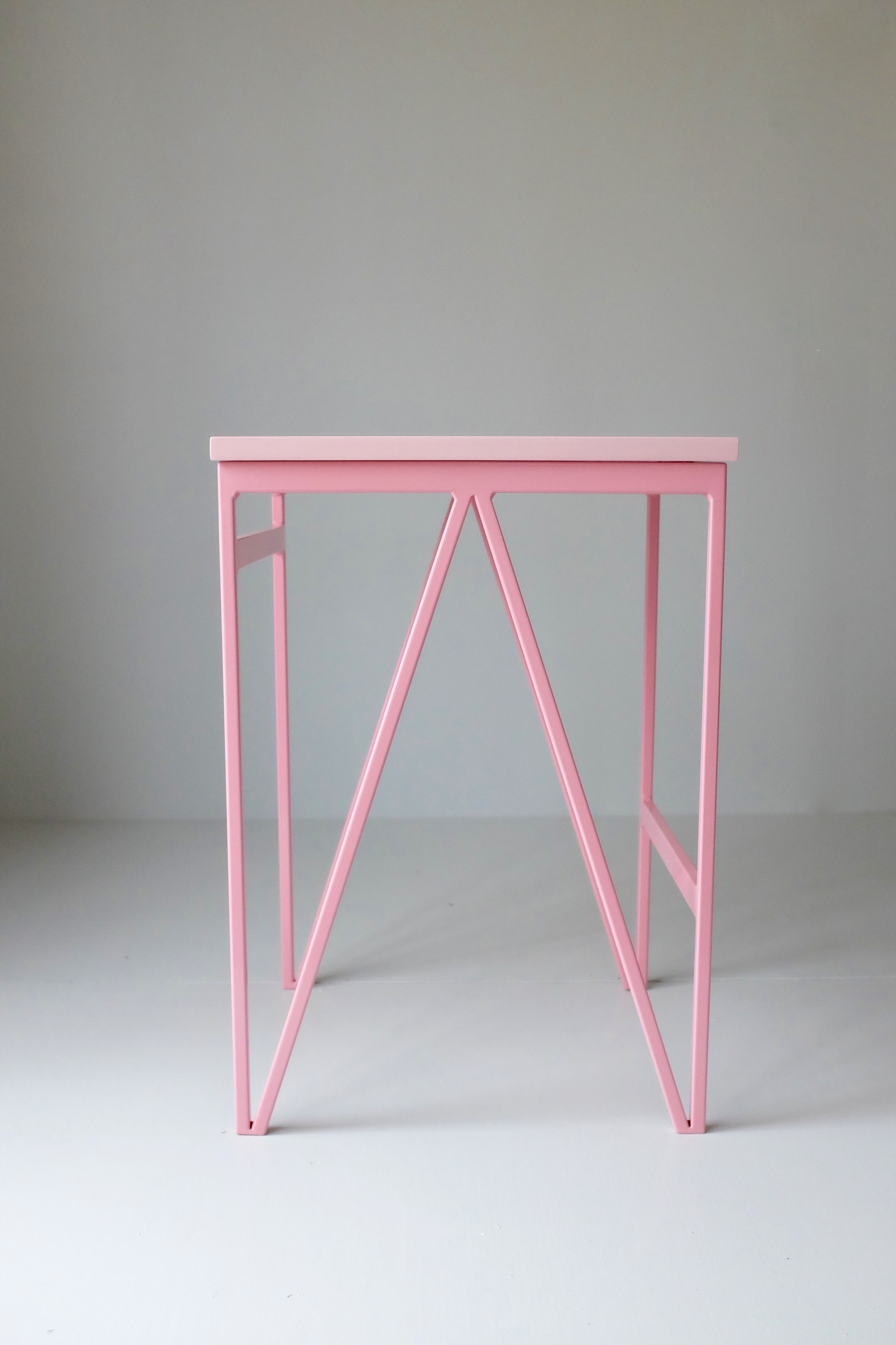 Pin powder coated steel frame and pink colour lacquered plywood top minimal modernbritishfurniture powdercoatedsteel stool