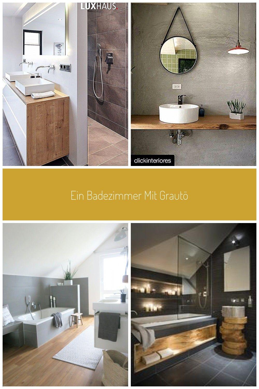 Ein Badezimmer mit Grautöne, stets kombiniert mit Holz und Weiß