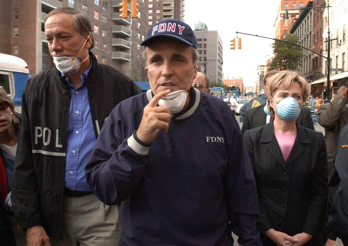From left, New York Gov. George Pataki, New York City Mayor Rudolph Giuliani and U.S. Senator Hillary Rodham Clinton tour the site of the World Trade Center disaster on Sept. 12.