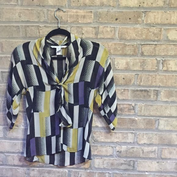 DIANEvonFURSTENBURG 🌉 silk blouse Perfectly professional silk blouse half sleeve blouse. Pretty black, purple, and yellow pattern with a tie front. Diane von Furstenberg Tops Blouses