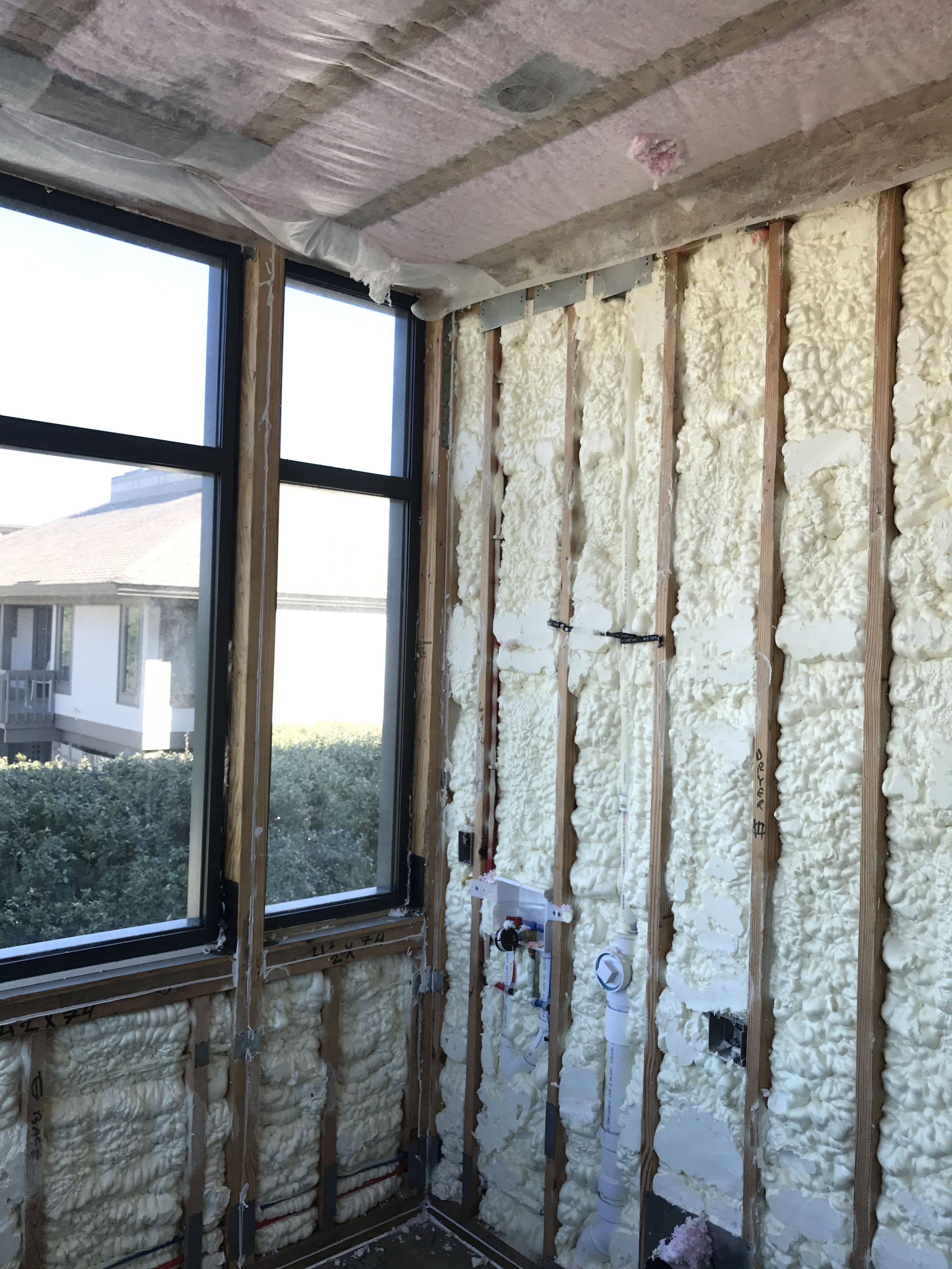 Spray Foam Insulation On The Exterior Walls With Dense Pack