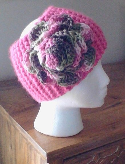 Ear warmer knit in Honolulu pink yarn, rose crocheted in camo pink yarn, done by Jodi Villanella