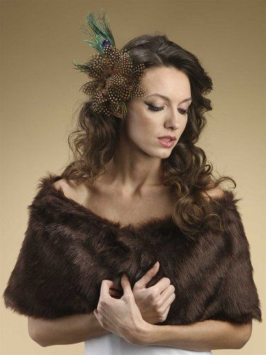 """Elegant Bridal's Faux Fox Fur Wrap in Brown Mink Fox by Mariell. $89.95. Mariell's luxurious Faux Fur Bridal Wrap in exquisite Brown Mink Fox will add both warmth and glamour to your wedding day. This top-selling fur stole will bring dramatic beauty to your bridal gown, holiday party, prom or special occasion. Our sensational fox wedding wrap measures 48"""" w x 11"""" h and includes a hook ad eye closure. Add one of Mariell's beautiful brooches (not included) to top off this look wi..."""