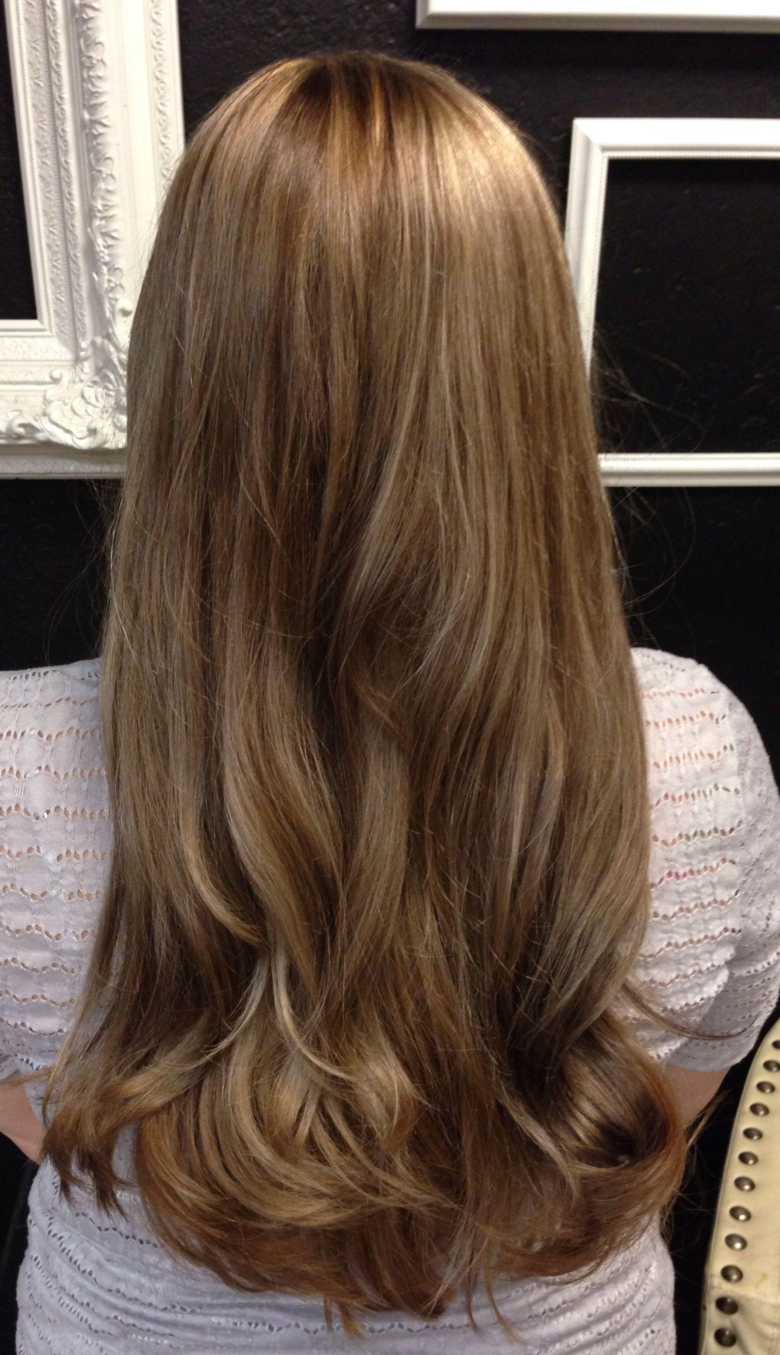 Medium brown with beigegolden tones subtle blonde highlights