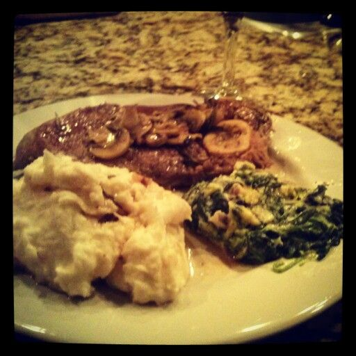 Was craving lamb... But can't really afford it at a restaurant so... Pan seared lamb steak with Rosemary, white wine and mushrooms. Mashed potatoes and creamed spinach. I'm getting SO much better at this cooking thing...