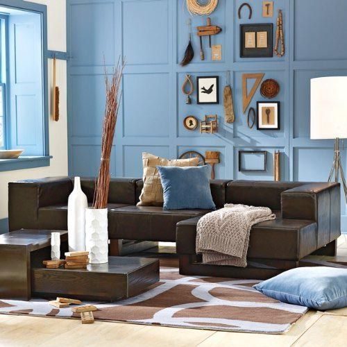 Light Blue Accent Wall And Dark Brown Leather Couch Living Room