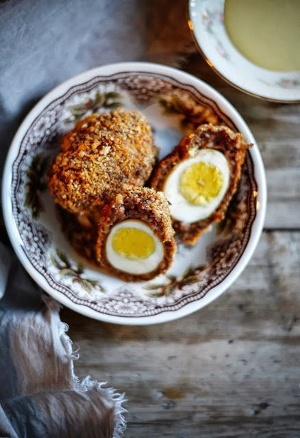The most delicious Baked Scotch Eggs EVER! SO good! Served with sriracha sauce for a grown up kick or a mustard sauce. You choose! #scotcheggs The most delicious Baked Scotch Eggs EVER! SO good! Served with sriracha sauce for a grown up kick or a mustard sauce. You choose! #scotcheggs The most delicious Baked Scotch Eggs EVER! SO good! Served with sriracha sauce for a grown up kick or a mustard sauce. You choose! #scotcheggs The most delicious Baked Scotch Eggs EVER! SO good! Served with srirach #scotcheggs