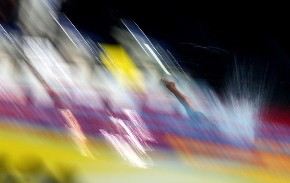 An athlete dives into the pool during the Swimming Women's 4x200m Freestyle preliminaries on day thirteen of the 15th FINA World Championships at Palau Sant Jordi on August 1, 2013 in Barcelona, Spain.