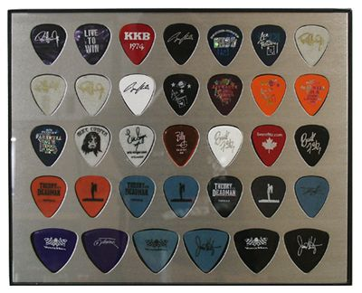 Frame Guitar Picks From Old Shows In Spare Bedroom