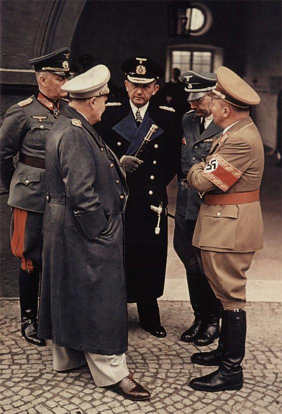 Five war criminals chatting: Wilhelm Keitel, Hermann Göring, Karl Dönitz, Heinrich Himmler and Martin Bormann in conversation at a train station near the Obersalzberg. The bad guys always seem to have nice uniforms and footwear.