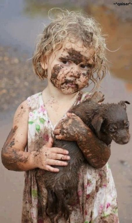 Wasn't me. Little girl and dog covered in mud; play   Kids with ...