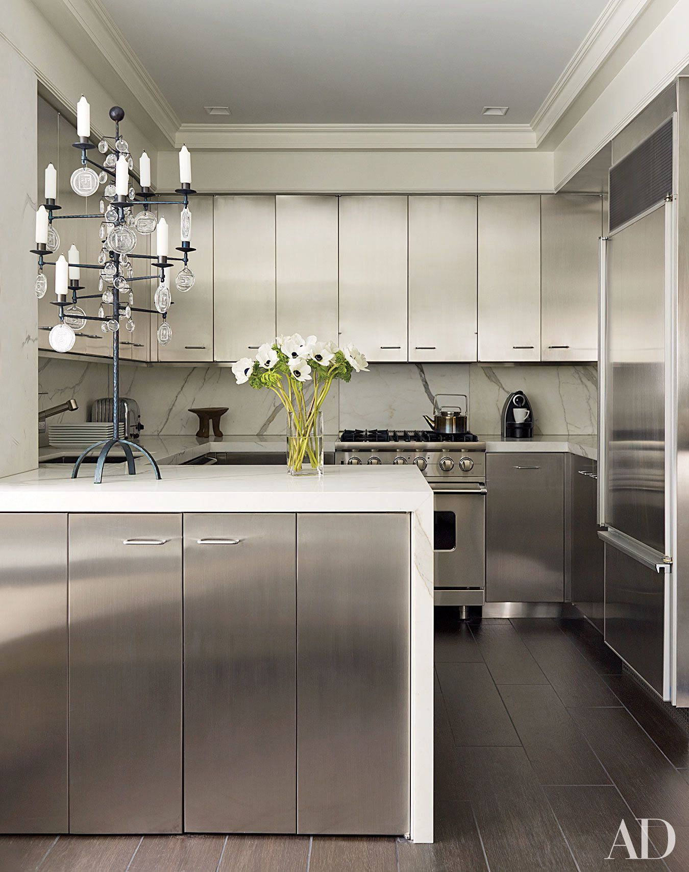 These 12 Metallic Rooms Really Shine Stainless Kitchen Kitchen Marble Steel Kitchen Cabinets