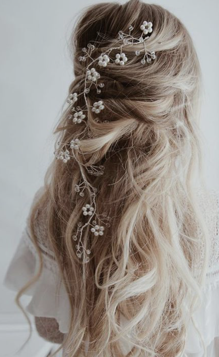 white flowers in hair   romantic curls and loose braids