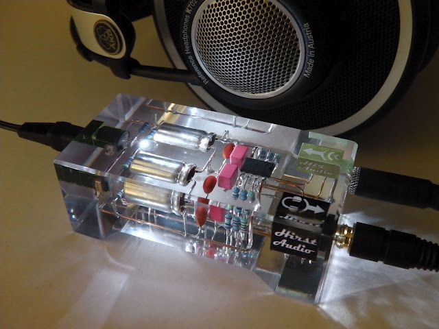 A hand built headphone amp encased in clear resin BEAUTIFUL - p & l form