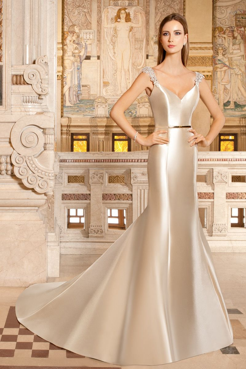 This sultry mikado wedding gown features a vneckline sheer jeweled