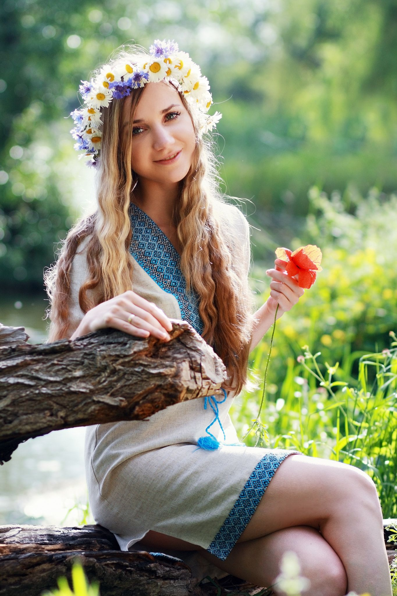 Beautiful ukrainian woman with flower wreath in fresh summer morning beautiful ukrainian woman with flower wreath in fresh summer morning izmirmasajfo Image collections