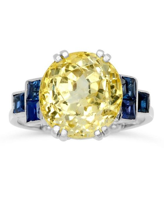 An Art Deco Yellow Sapphire And Sapphire Ring Centring An Oval Yellow Sapphire Weighing Approximately 7 75 Amazing Jewelry Art Deco Jewelry Beautiful Jewelry