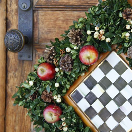 Square-shaped Christmas wreath: frame of boxwood leaves, studded with apples and white berries...hang on diagonal, if desired (checker board optional!)