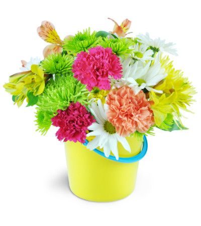 Life's a beach, and they'll think this bouquet is buckets of fun! Beautifully bright summer flowers burst from a fantastic yellow beach pail!  Includes carnations, alstroemeria, and daisies in hot pinks, lime greens, and bright yellows, perfectly arranged in a plastic beach bucket!