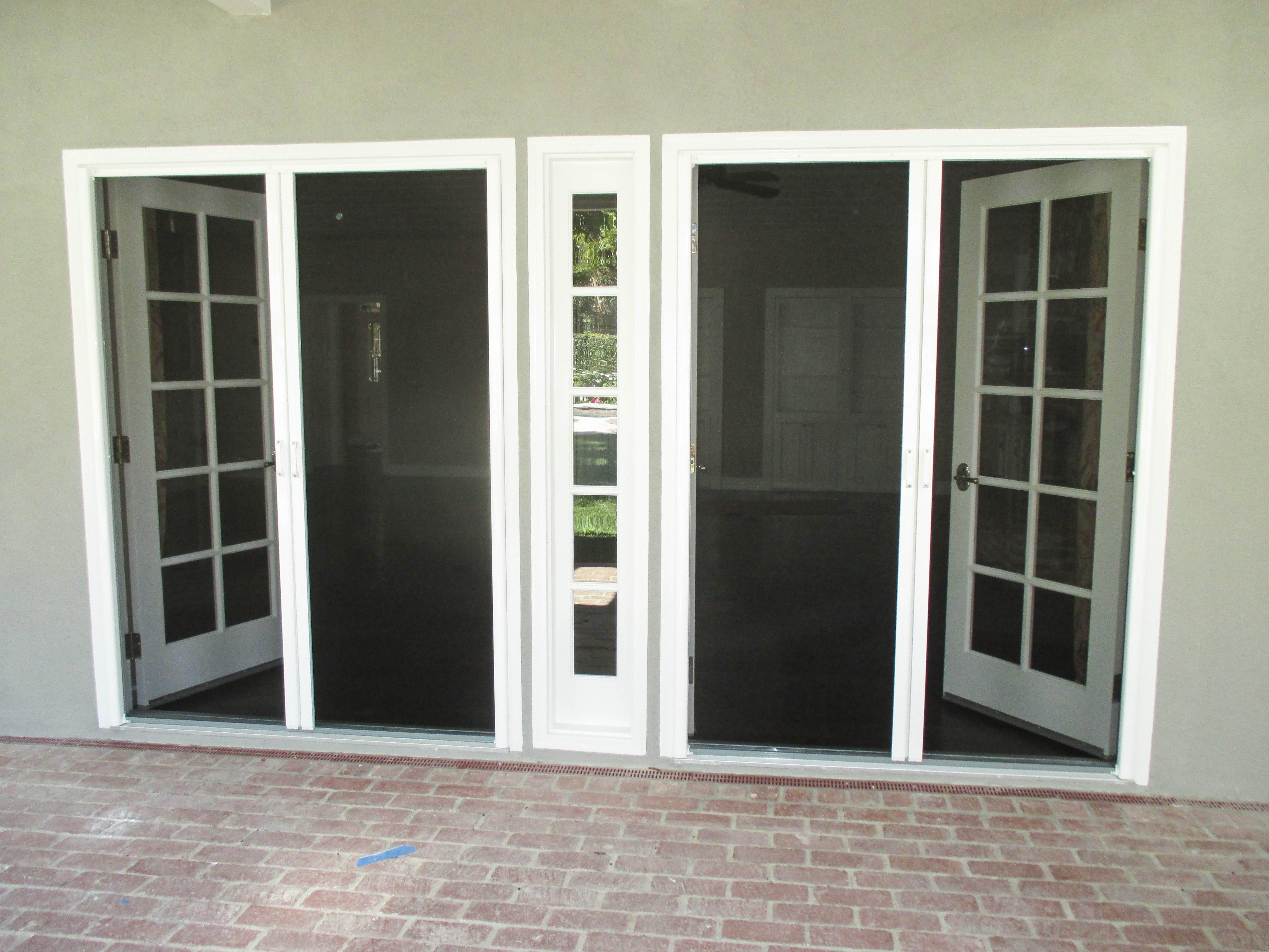 Check Out This Pair Of Double Door Inswing Bright White Stowaway Retractable Screen Doors That Our Team Installed On Shutters Exterior Screen Door French Doors