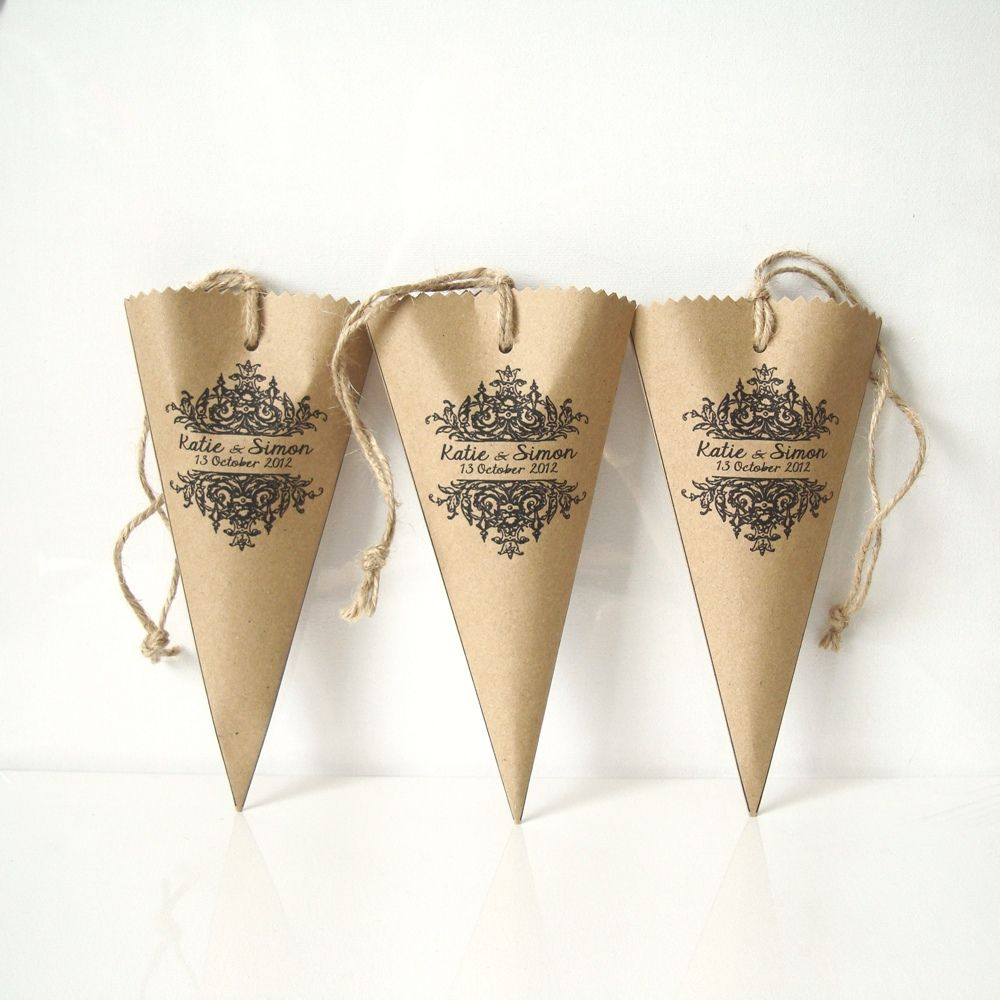 wedding favour wrap in a shape of cones made from brown kraft paper ...