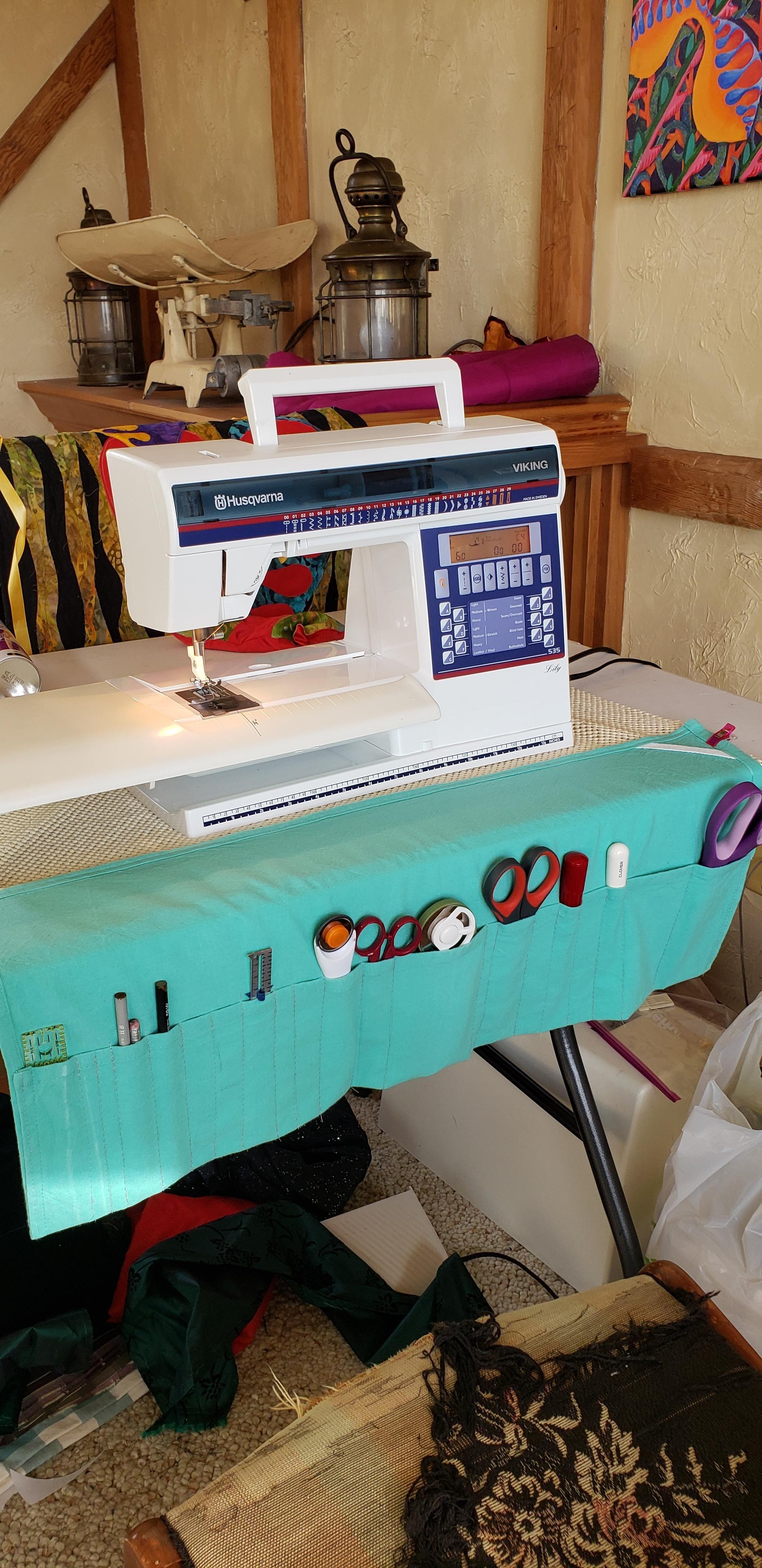 Super simple organizer. Tea towel folded over & sewn ...
