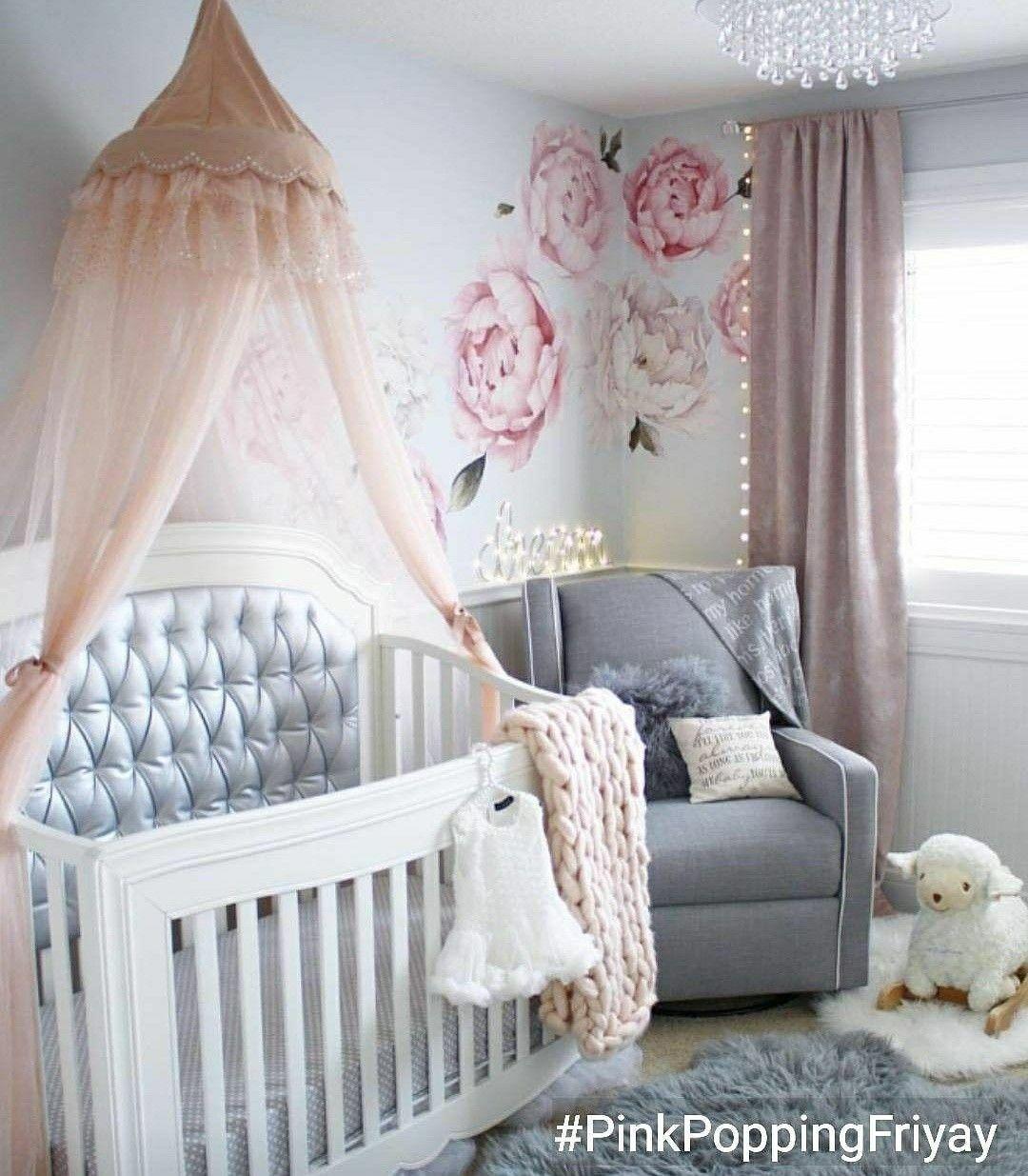 Baby nursery in pink and grey. Baby girl nursery pink