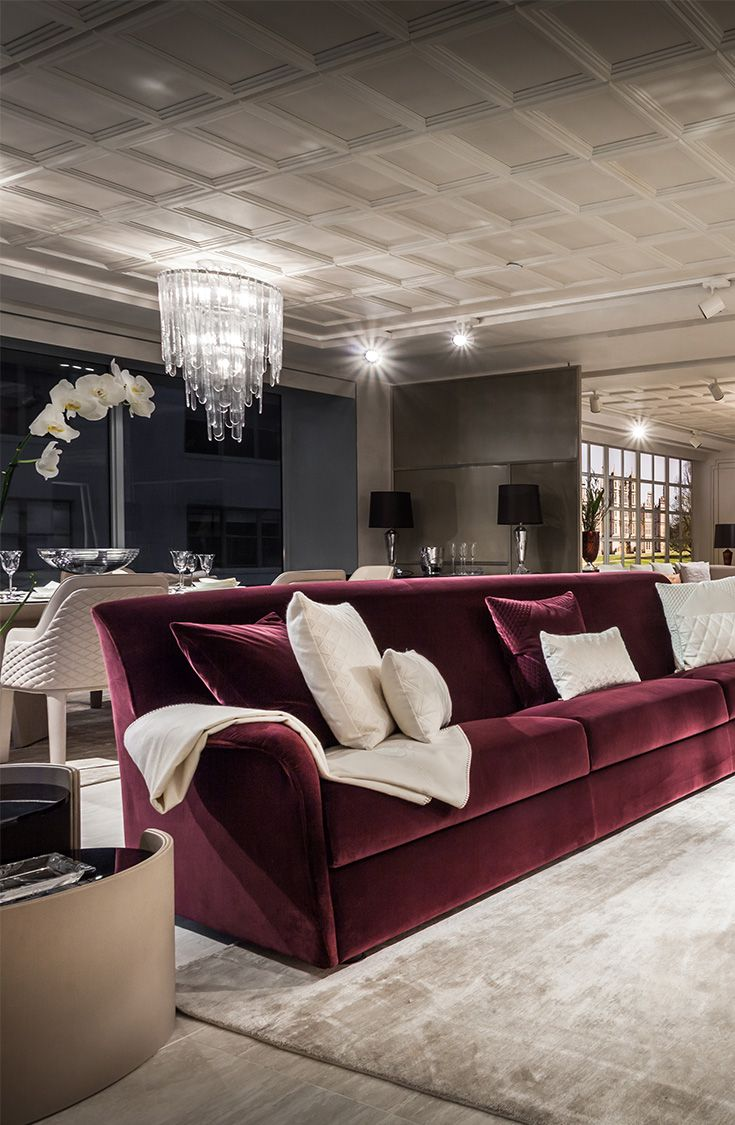Bentley Home living room with elegant bordeaux sofa combined with