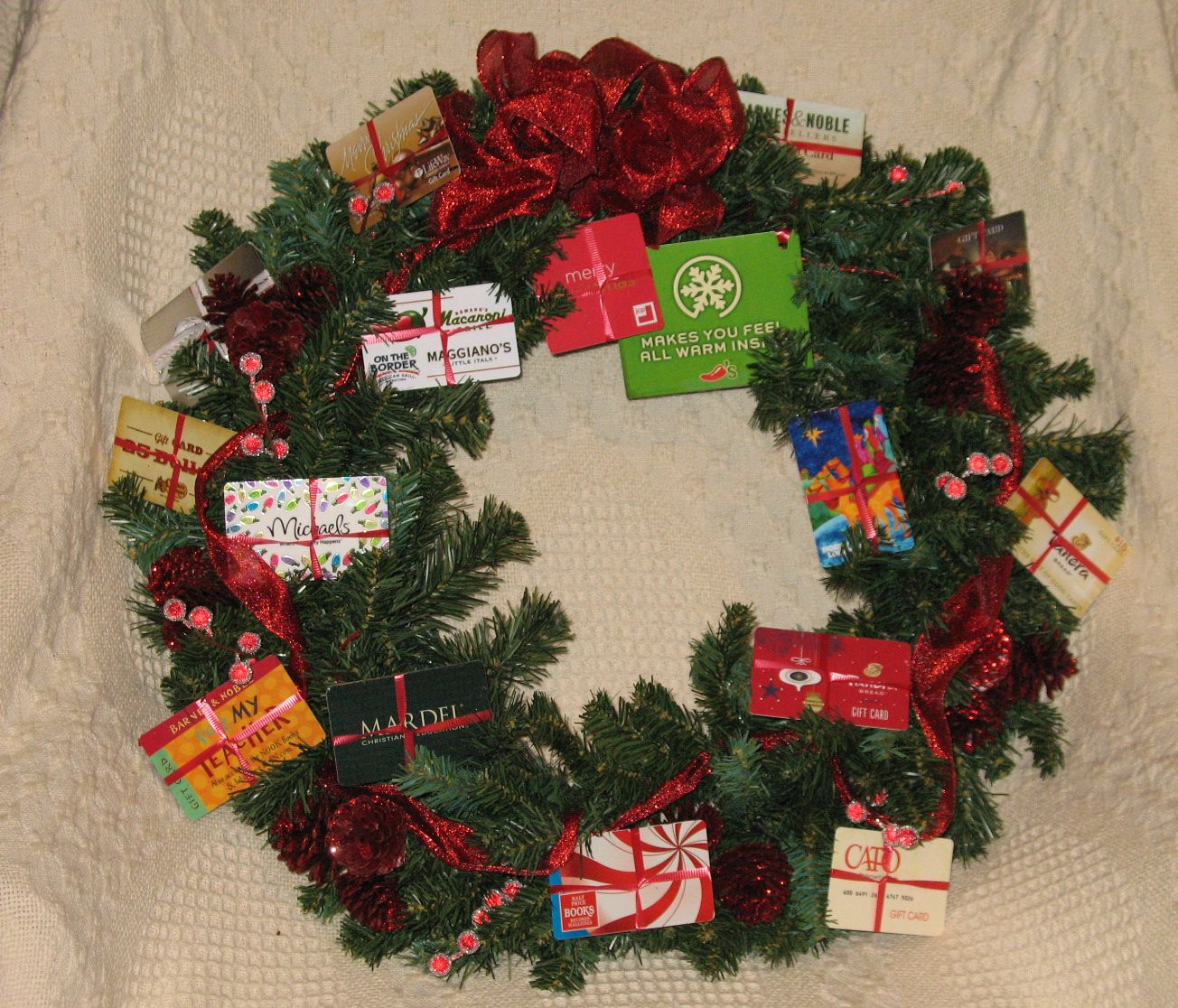 This Was The Gift Card Wreath For My Daughter S Third Grade Class Used Curly Ribbon To Attach Each C Teacher Christmas Gifts Gift Card Tree Gift Card Bouquet