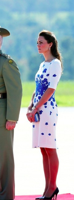 Catherine, Duchess of Cambridge, aka Kate Middleton, at the Royal Australian Air Force base at Amberley. She is wearing the Lasa Poppy Dress by LK Bennett,  Oroton Odeion clutch, suede Alexander McQueen pumps, her diamond and sapphire earrings, and Mappin & Webb Fortune necklace. 4/19/14
