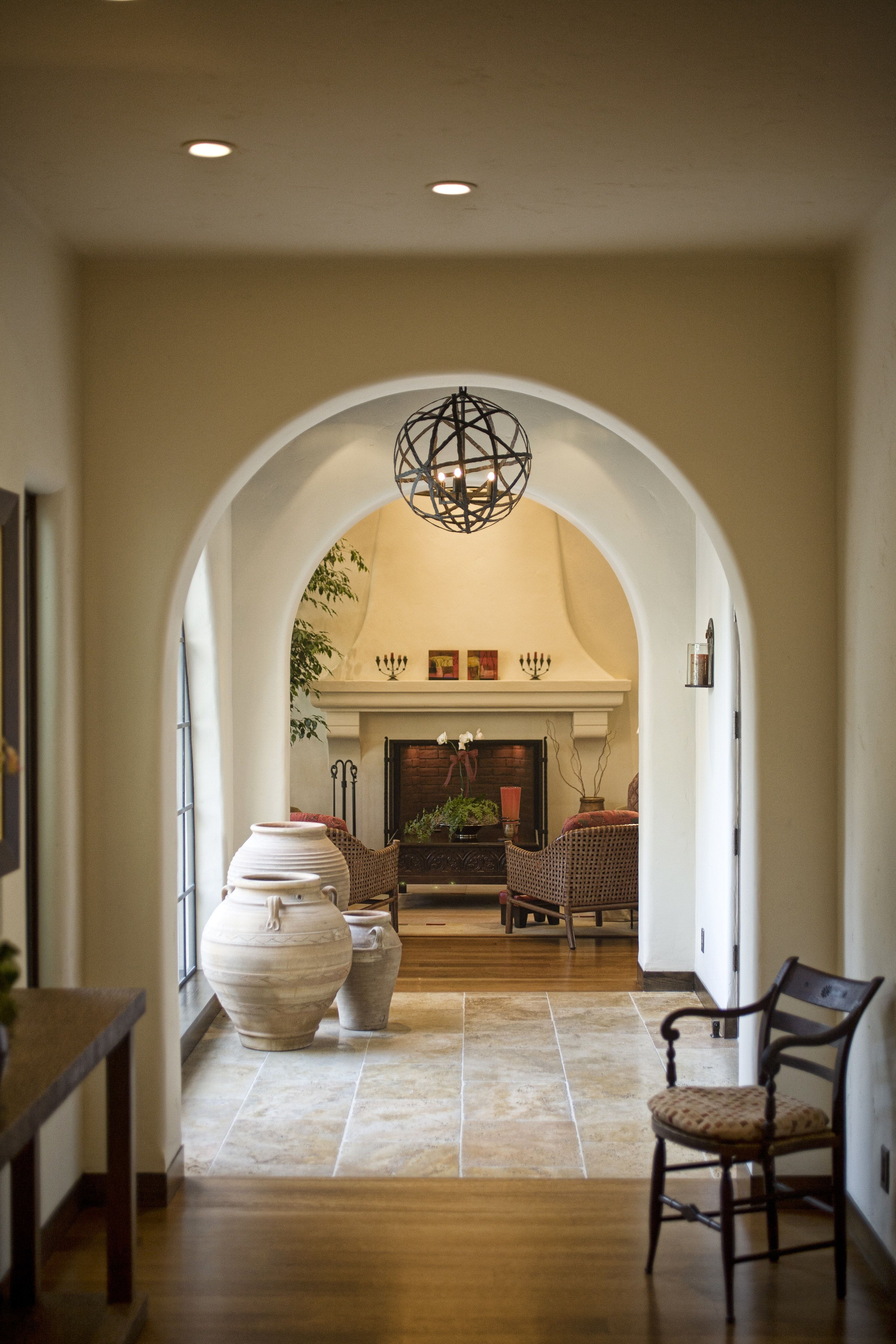 Spanish Colonial Home Hallway With Archways Inlaid Tile Floor And Fireplace By Fergus Garber Young Architects