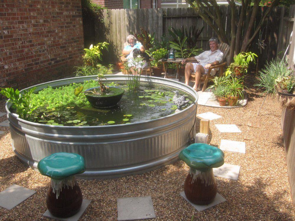 Here 39 s a round above ground garden pond our little nest for Above ground pond ideas
