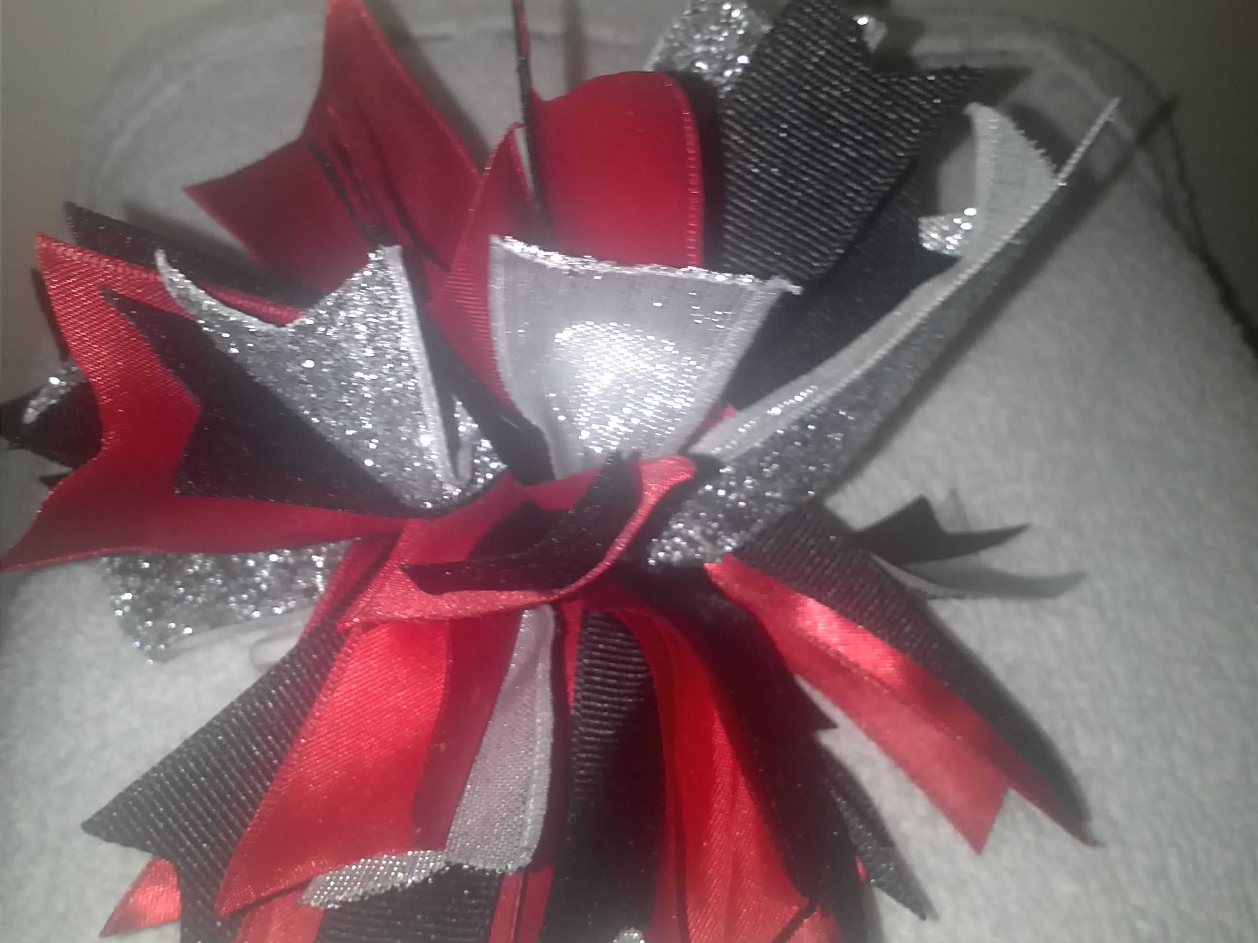 Wildcats Firecracker bow in red, black, and silver