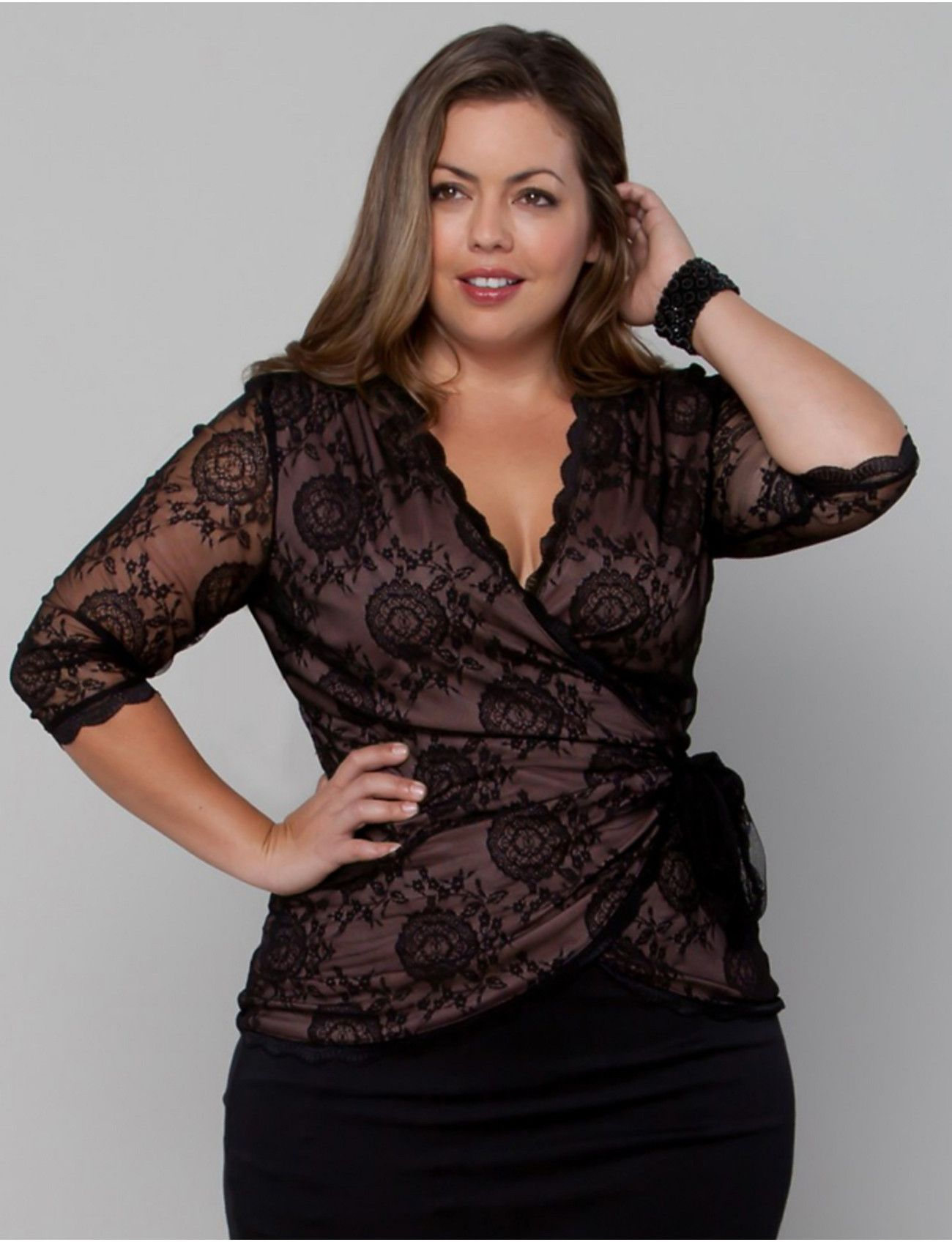 86b03277a46 Check out how GORGEOUS this new lace Juliet Wrap Top by Kiyonna is! We  think this would be PERFECT for dinner dates   formal events this fall.