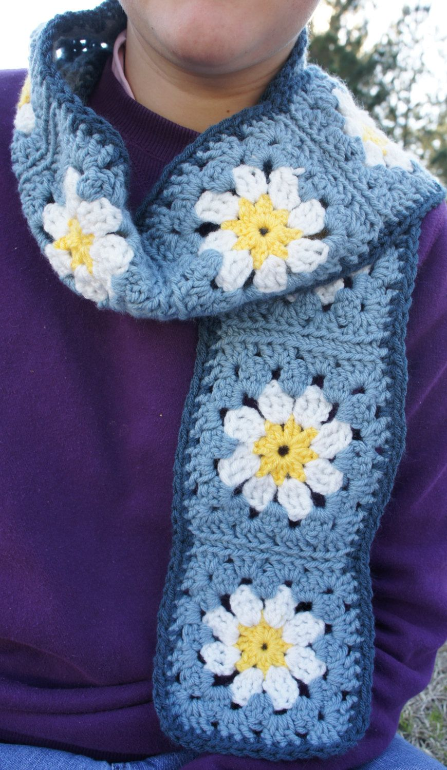 Crochet white daisy granny square scarf in blue pinned