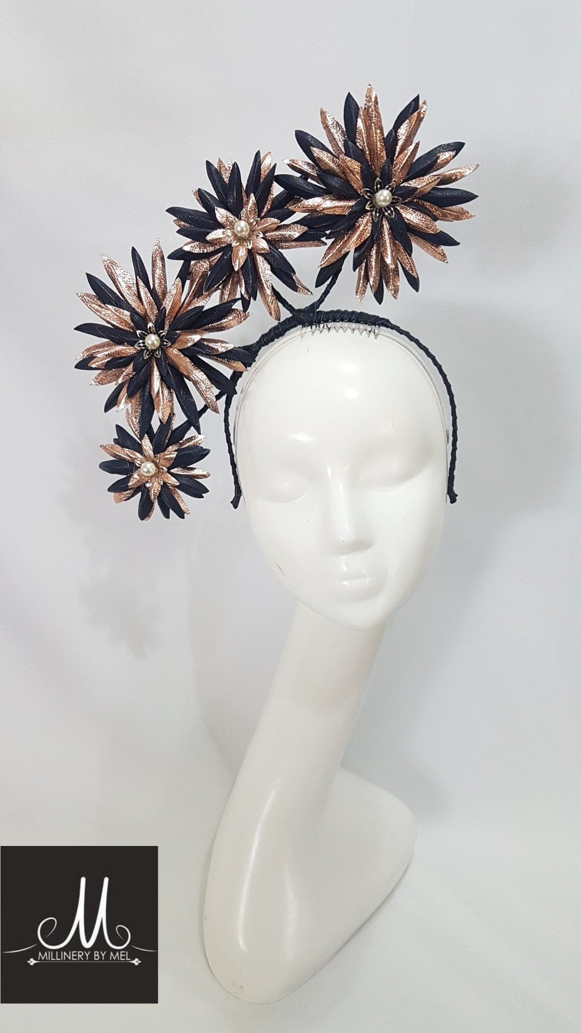 626cc5acc11 Millinery By Mel Navy and rose gold leather fascinator  millinerybymel  www.millinerybymel.com.au