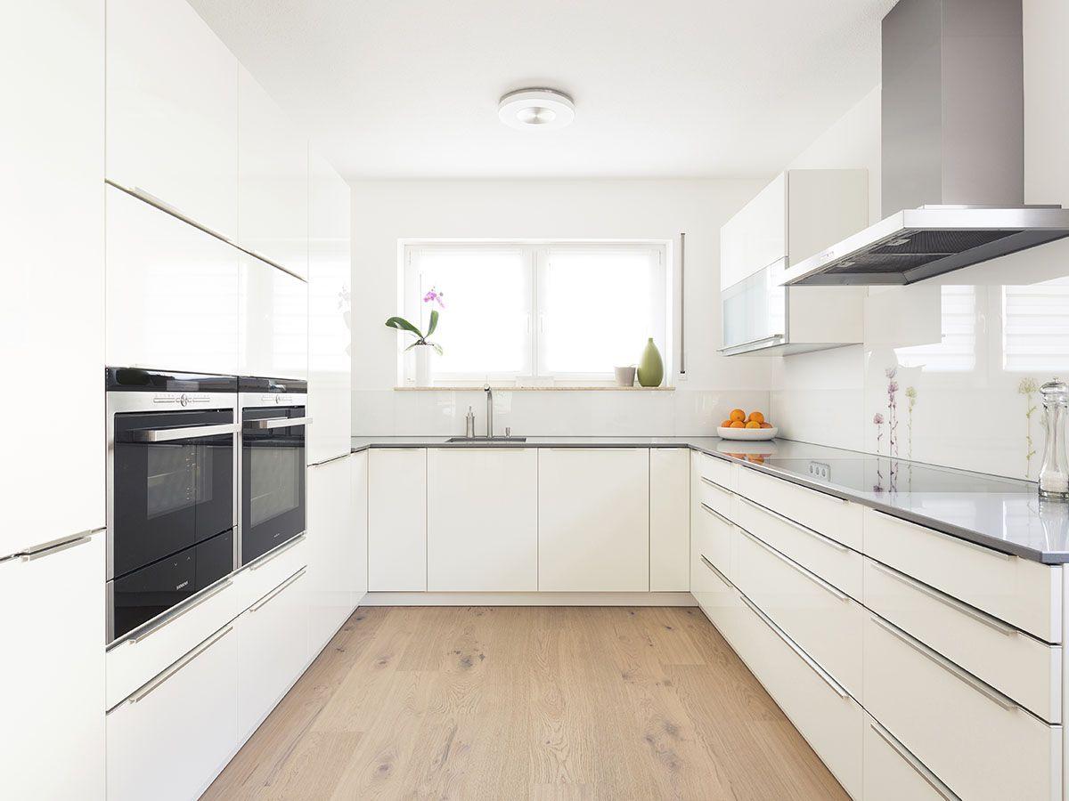 Benowa Kitchen: U-shaped, white cabinets, grey benchtops, timber ...