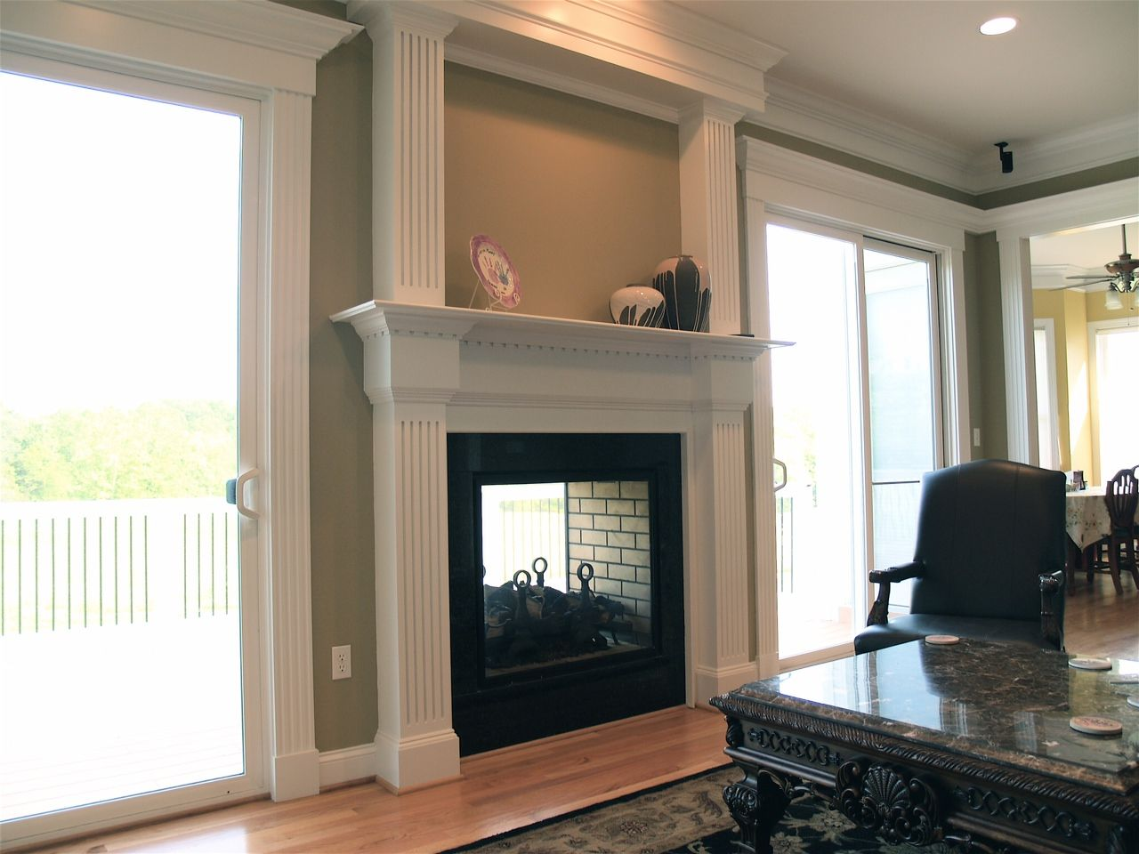 double mantel with granite surround and indoor outdoor fireplace