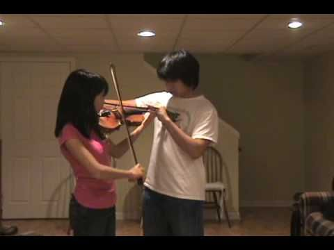 """""""Don't Stop Believing"""" - 2 violinists on one violin."""
