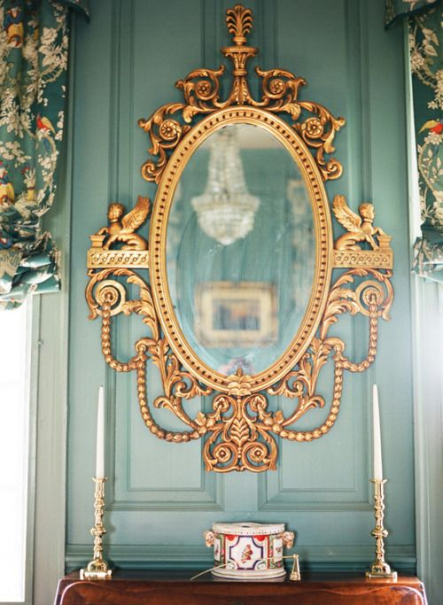 Gold ornate mirror + curtain pattern + that blue. Not my usual taste, but I love everything about this.