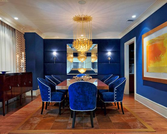 Eye Catching Royal Blue Dining Room With Painted Walls And A Back Drop Of Horizontally Upholstered Panels Huge Center Mirror Flanked By