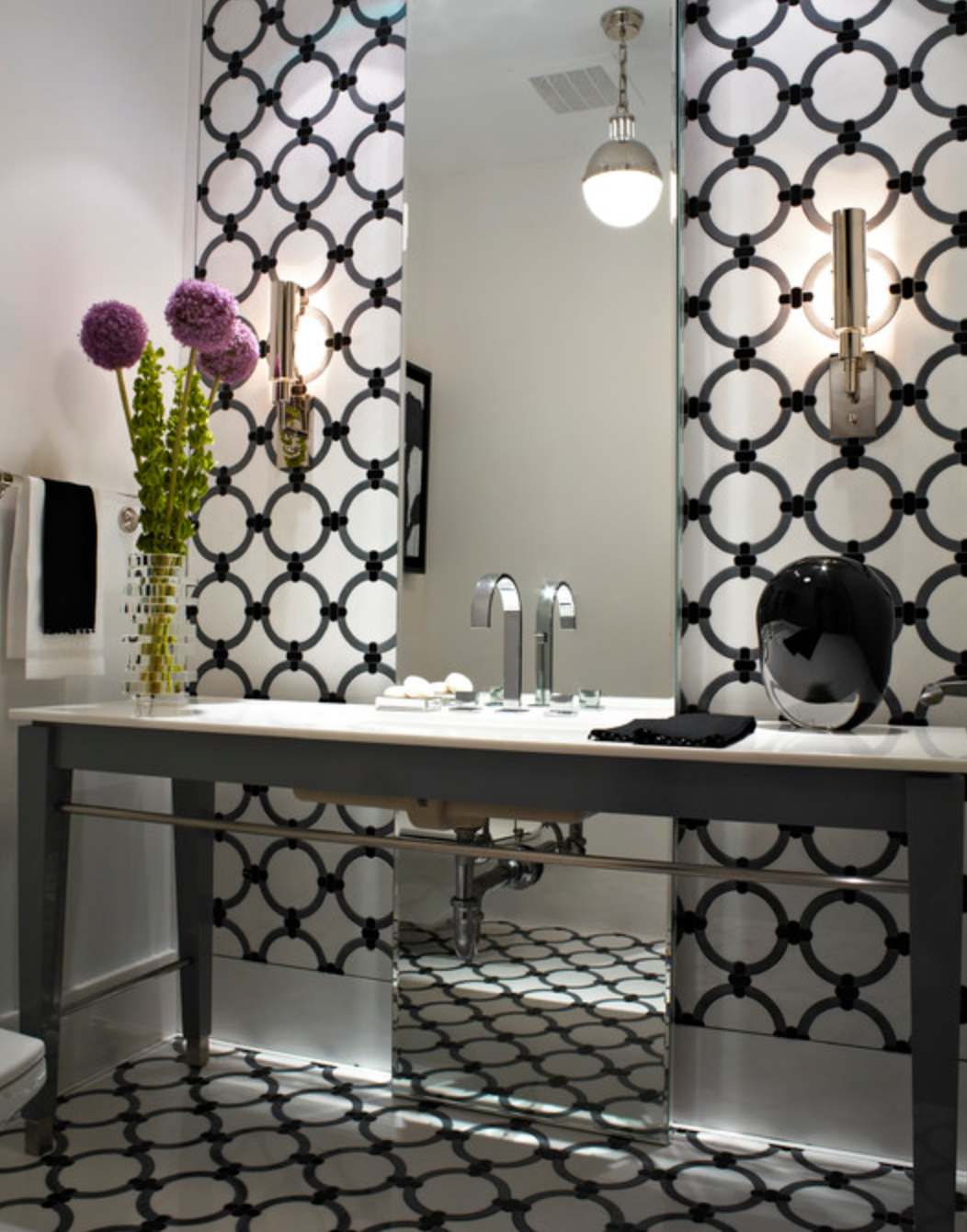 The chic black and white wallpaper and art deco lighting